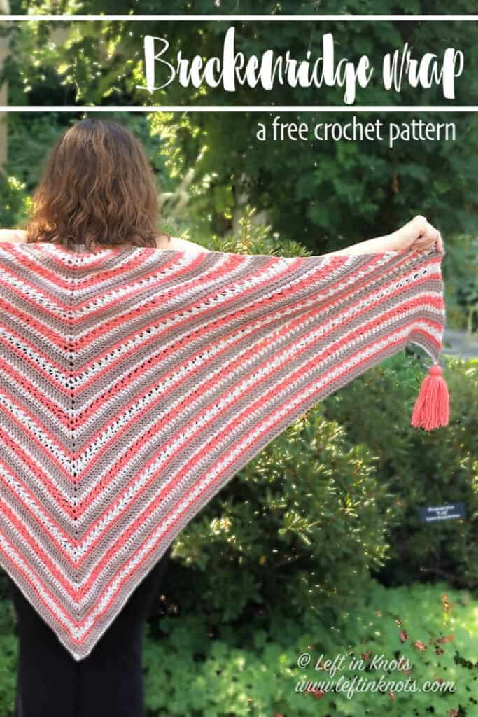 A crochet shawl made with textured stitches and tassels