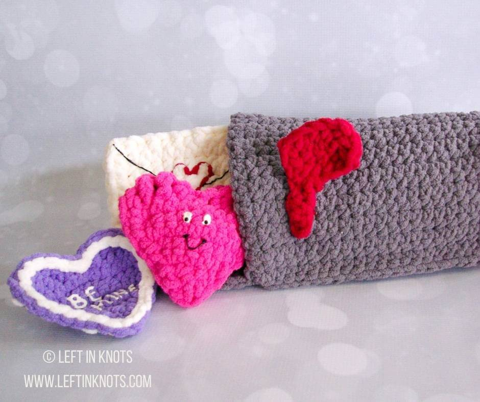 A crochet Valentine's mailbox toy for babies