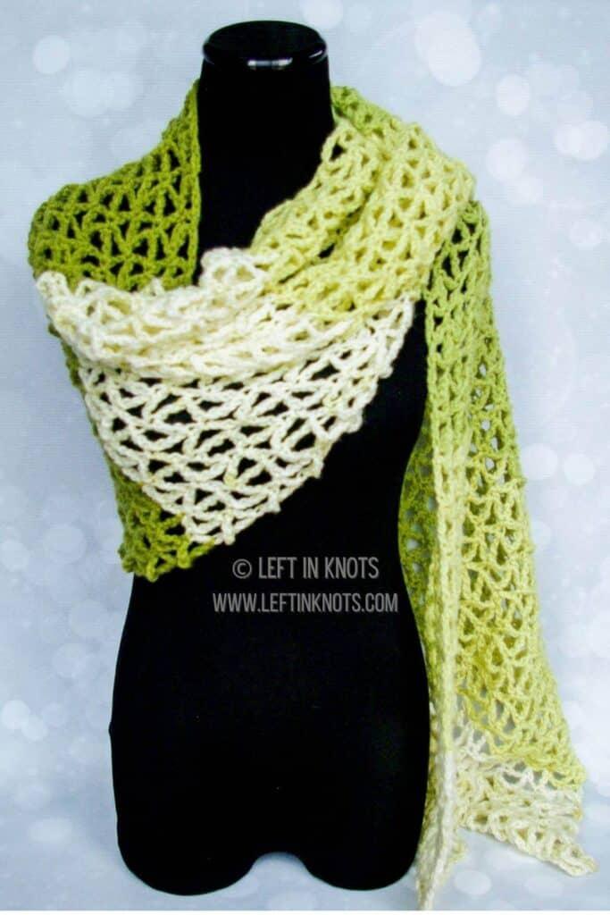 A green crochet triangle mesh wrap scarf