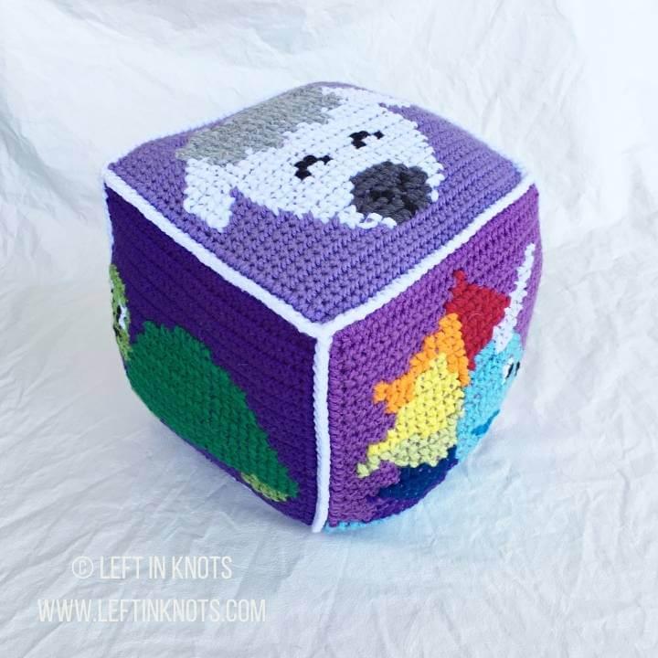 Purple crochet block with animals on it