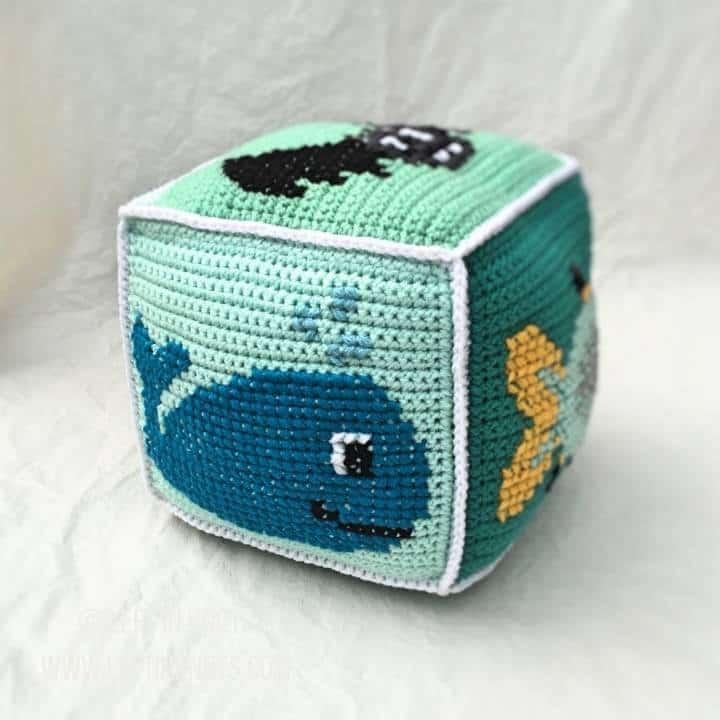 Mint crochet block with animals on it