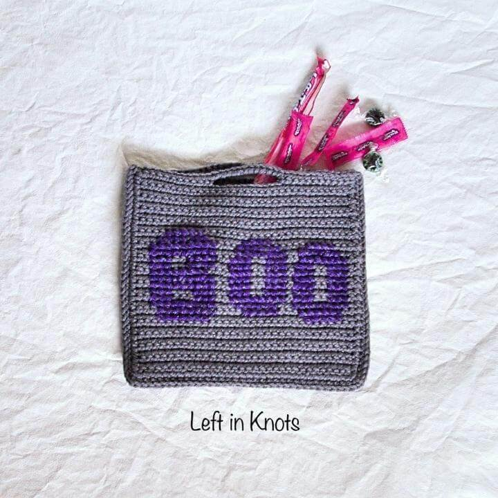 a small crochet trick or treat bag with reflective yarn