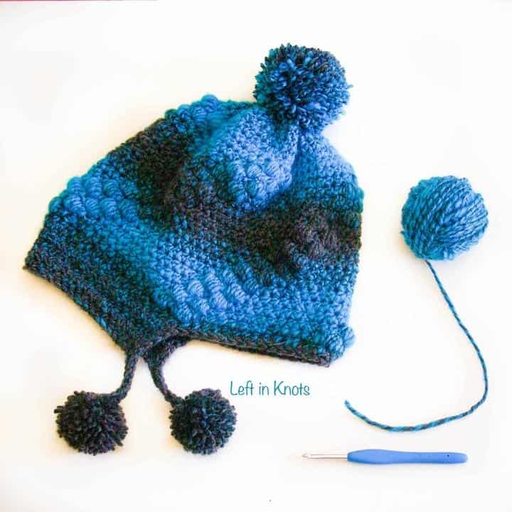 A crochet hat made with the bobble stitch and a brim