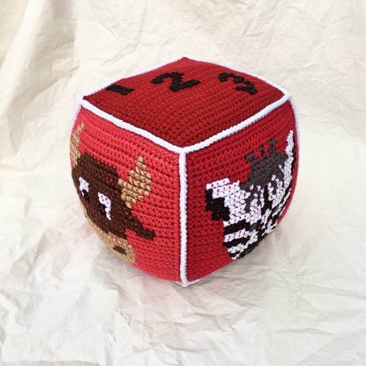 Red crochet block with animals on it