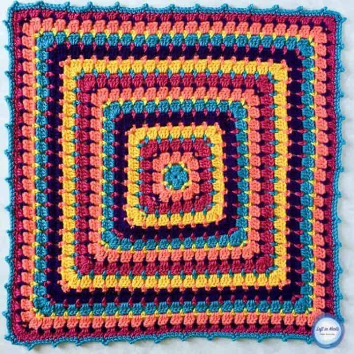 A colorful crochet baby blanket made with the block stitch
