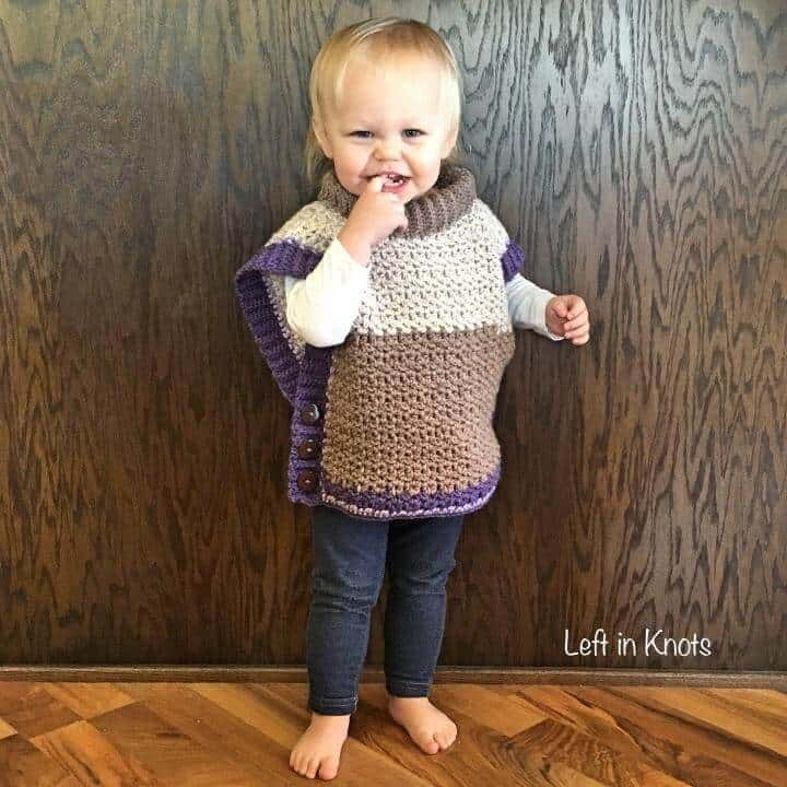 A crochet sweater poncho made with Caron Cakes yarn