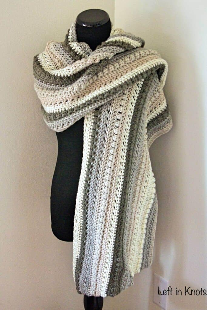 An oversized crochet scarf in neutral colors