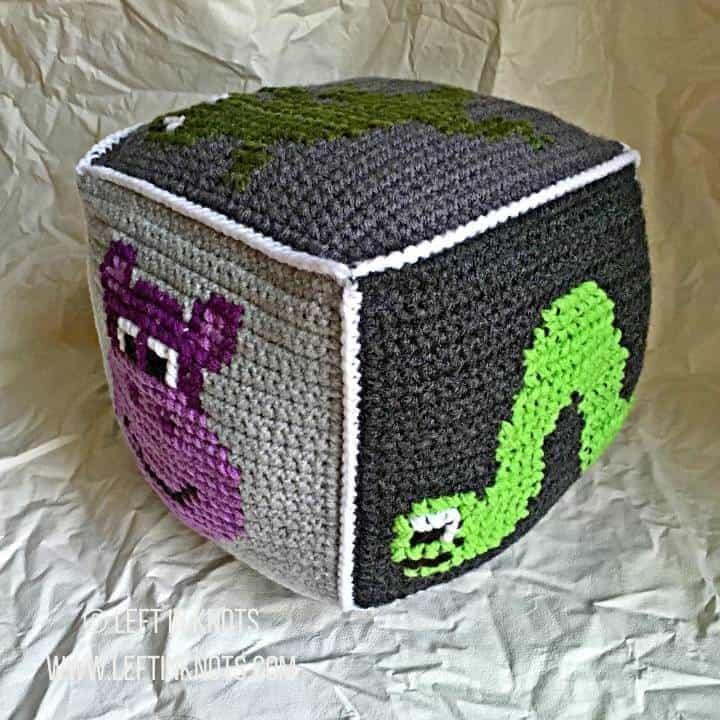 Gray crochet block with animals on it