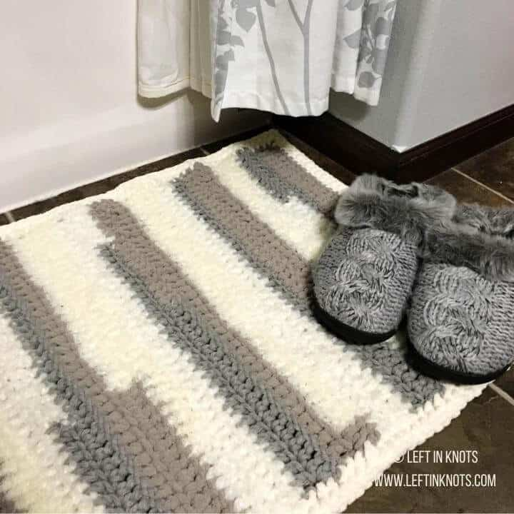 A crochet rug made with differently textured yarn
