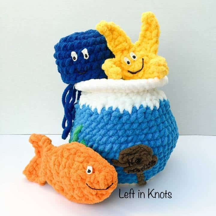 A crochet fish bowl with toy fish
