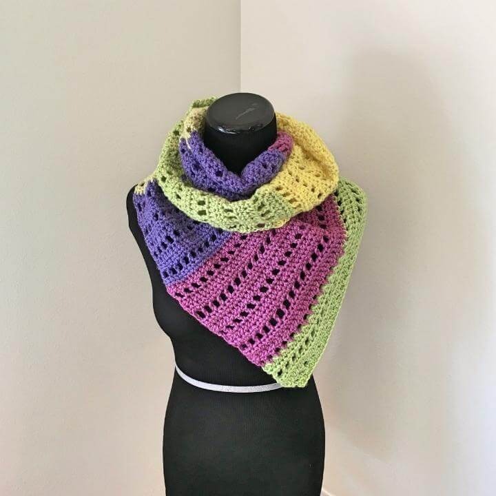 A fillet crochet scarf made with Caron Cakes
