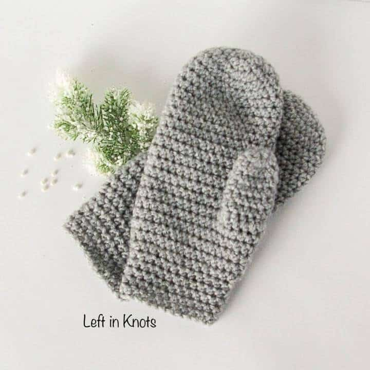a pair of fitted crochet mittens
