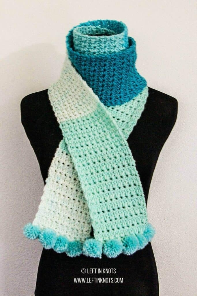 A skinny crochet scarf made with Caron Cakes yarn