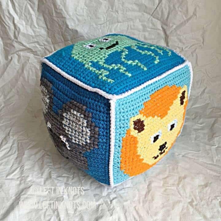 Blue crochet block with animals on it