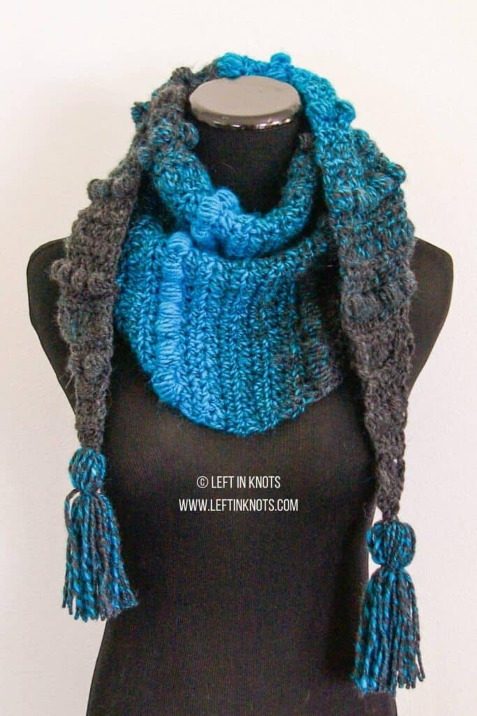 A blue and charcoal triangle crochet scarf