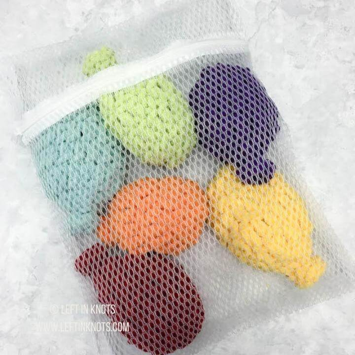Colorful crochet reusable water balloons packaged for selling at craft fairs