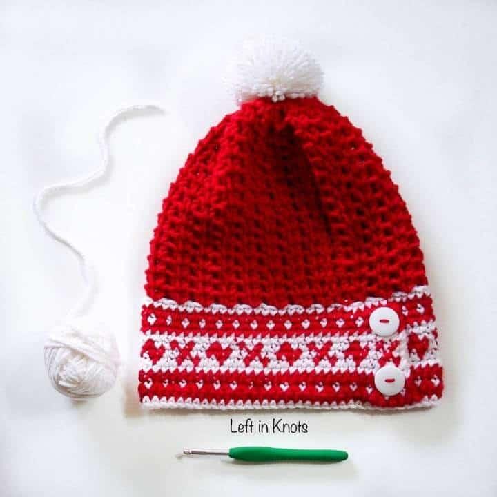 A red crocheted beanie with a fair isle band