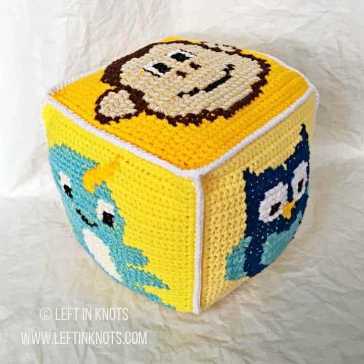 Yellow crochet block with animals on it
