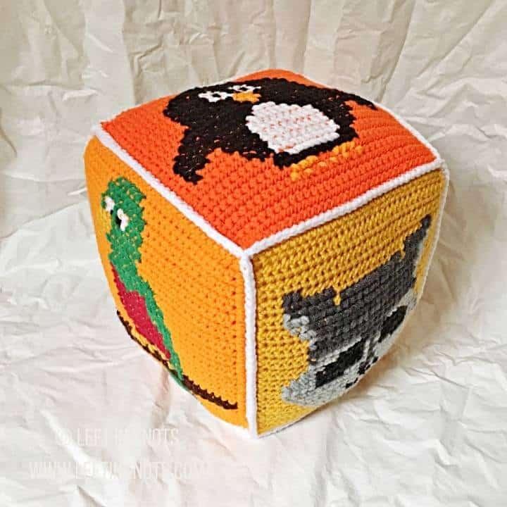 Orange crochet block with animals on it