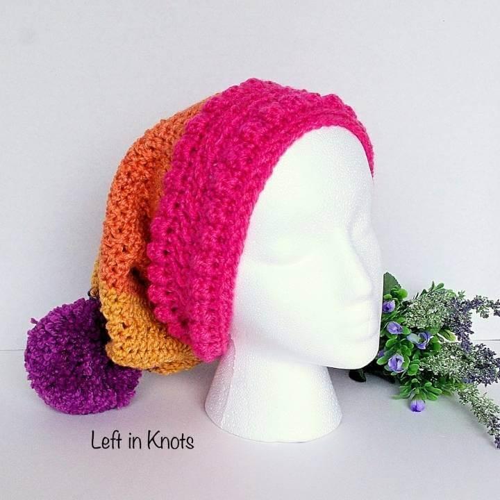 A slouchy crochet beanie in pink orange and purple yarn