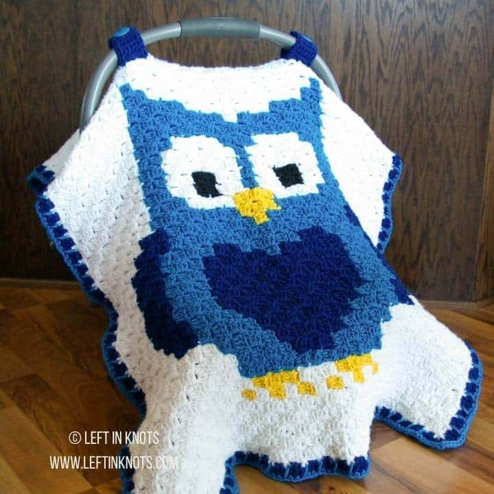 A C2C crochet car seat cover with an owl design