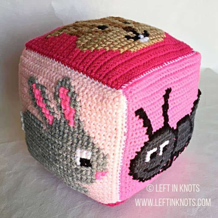 Pink crochet block with animals on it