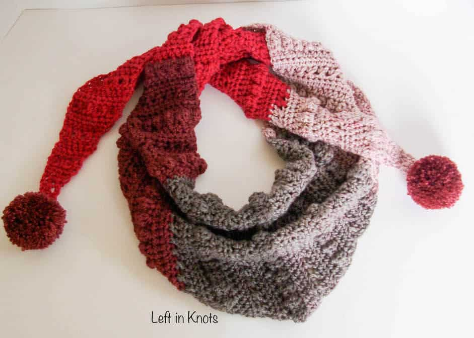 Crochet red and gray triangle scarf with pom poms