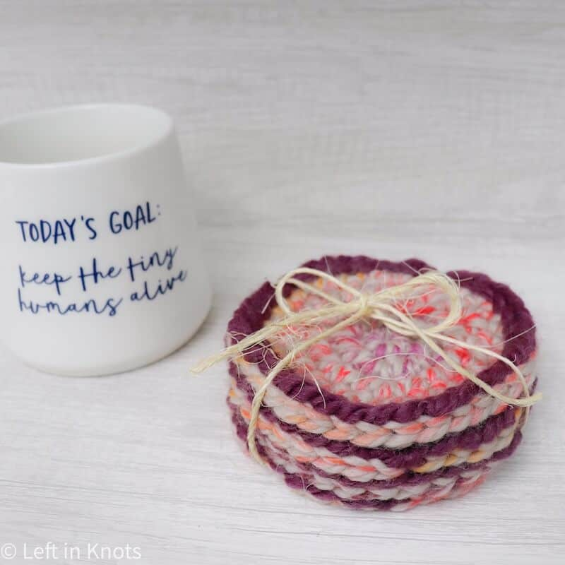 Crochet coasters made with scrap yarn used for a teacher gift