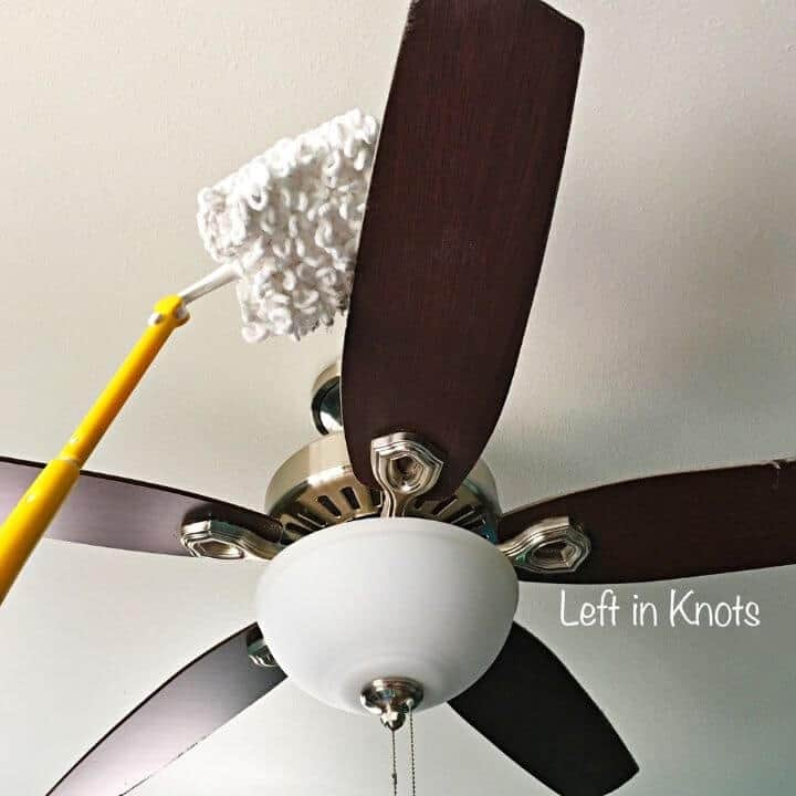A reusable swiffer duster cleaning a ceiling fan