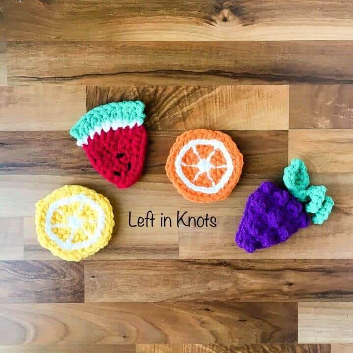 Crochet fruit sponges in lemon, watermelon, orange and grape shapes
