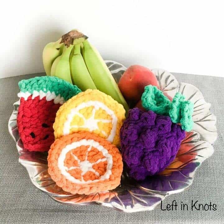 Crochet fruit sponges in a fruit bowl