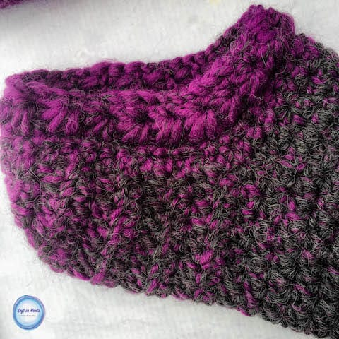 Purple and gray crochet slipper socks made with the star stitch