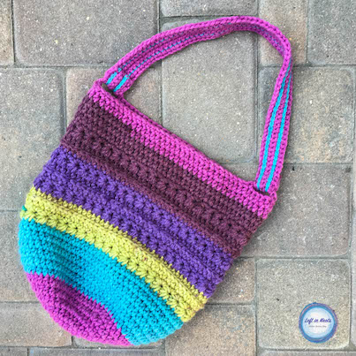 A color block crochet reusable market bag made with the star stitch
