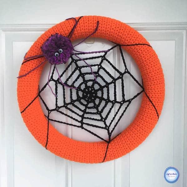 A crochet spider web wreath for Halloween