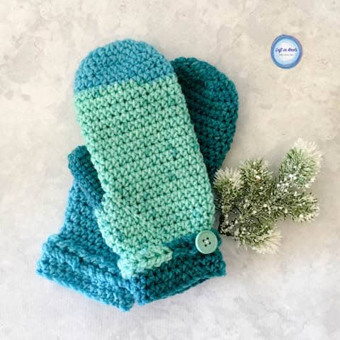 Turquoise crochet mittens with a braided cuff