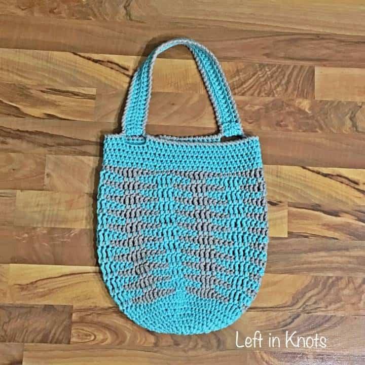 A reusable crochet bag made with bulky yarn