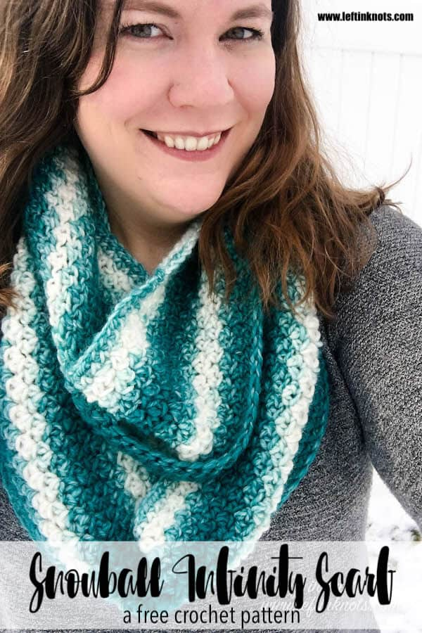 A teal and cream crochet infinity scarf made with the lemon peel stitch