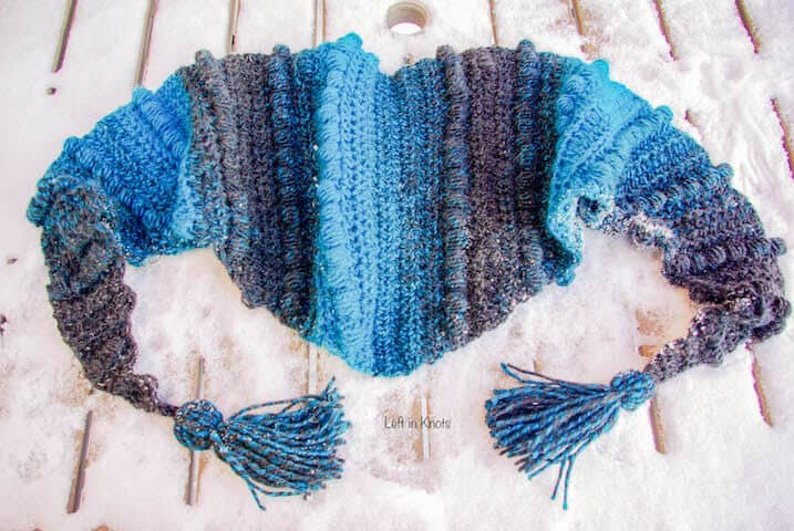 A triangle crochet scarf with tassels