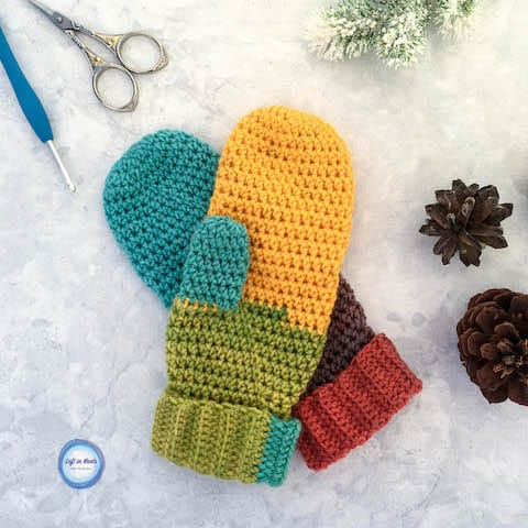 Rainbow crochet mittens with a folded cuff