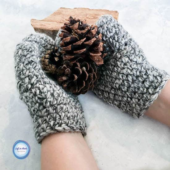 Chunky crochet women's mittens made with black and white yarn