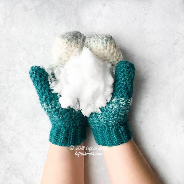 Teal and cream crochet mittens made with the lemon peel stitch