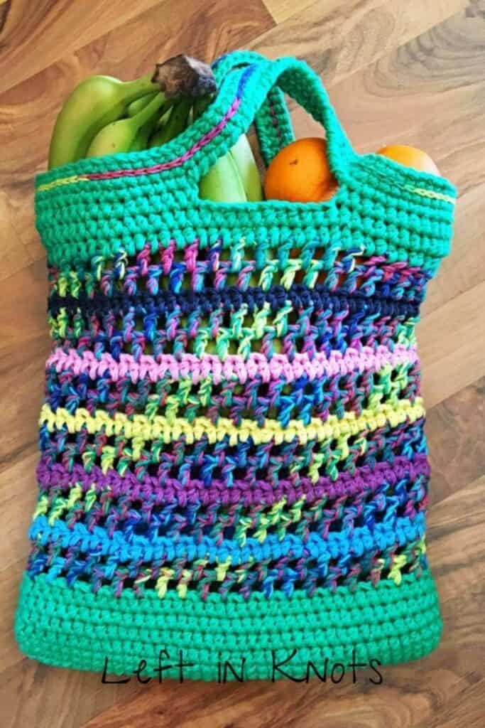 Colorful cotton crochet bag holding bananas and oranges