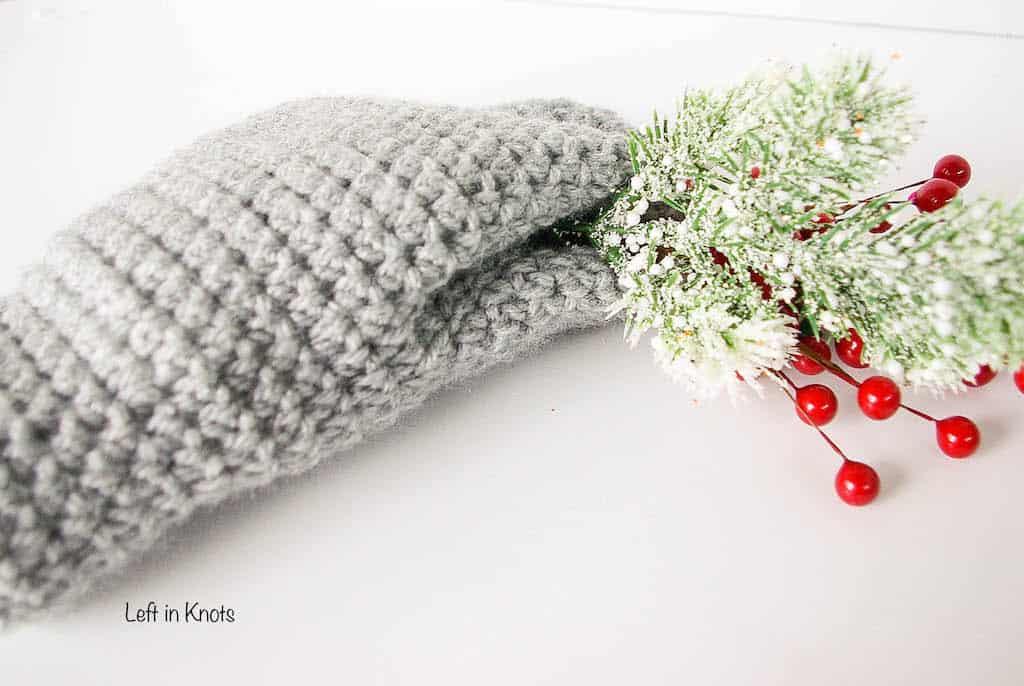 a gray crochet mitten