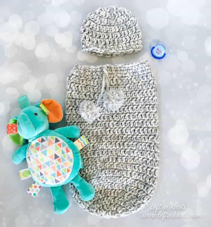 A gray gender neutral crochet newborn cocoon and hat set
