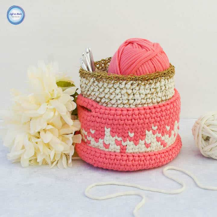 A set of small crochet baskets for holding hooks or desk supplies