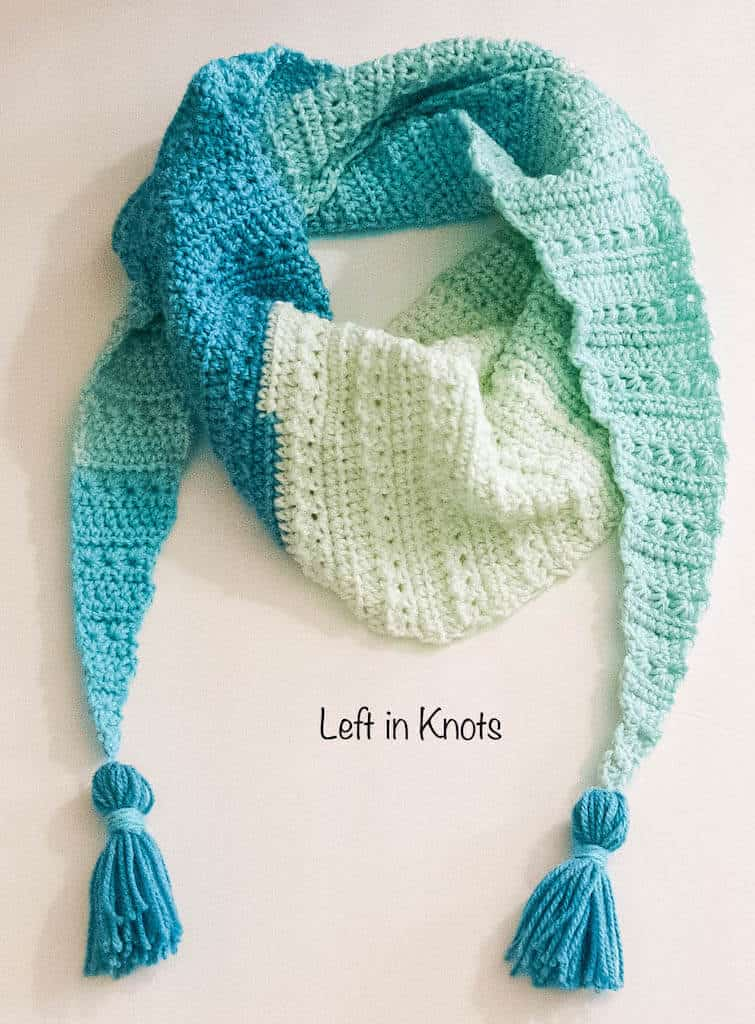 A modern crochet triangle scarf made with the star stitch