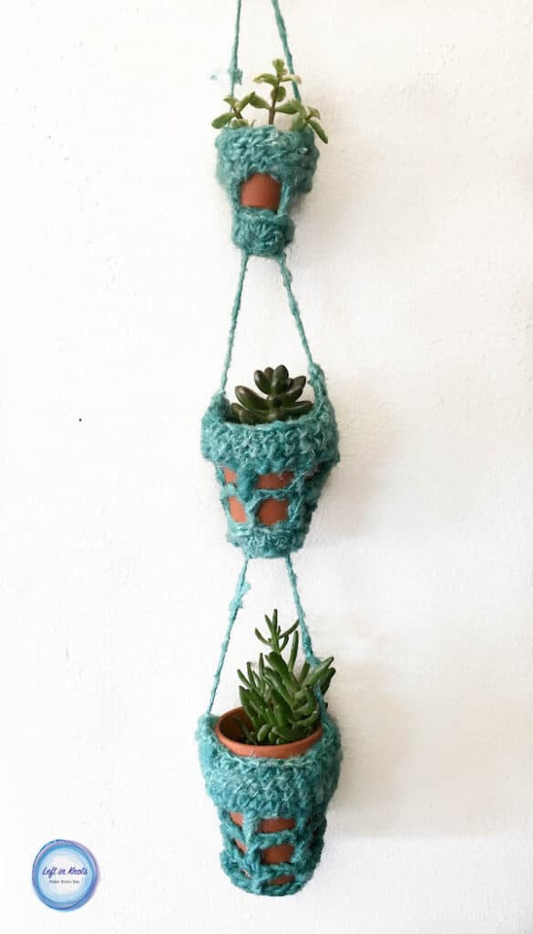 A crochet decorative succulent pot holder made with recycled yarn