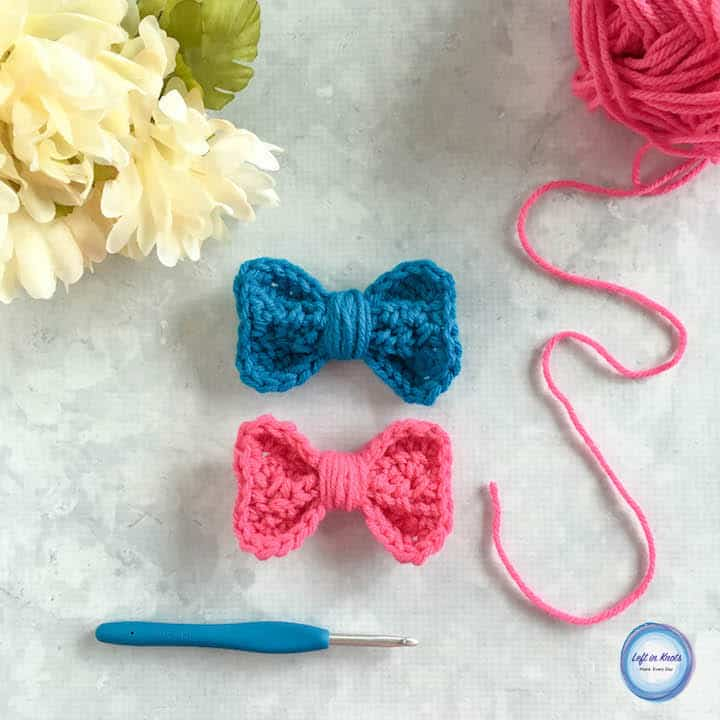 Two small crochet bows made with worsted weight yarn