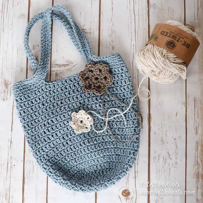 A small crochet bag with a flower embellishment