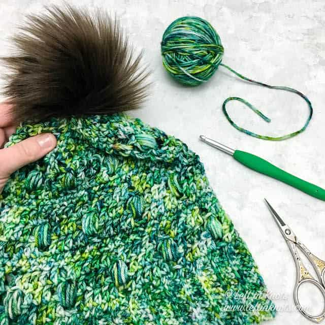 A crochet beanie made with one skein of hand dyed yarn and the puff stitch